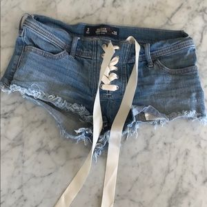 Adorable laced up denim shorts
